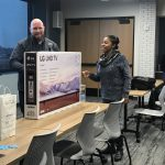 Attendee winning a 4K external monitor
